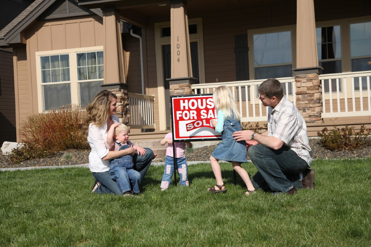 Family Buying Home